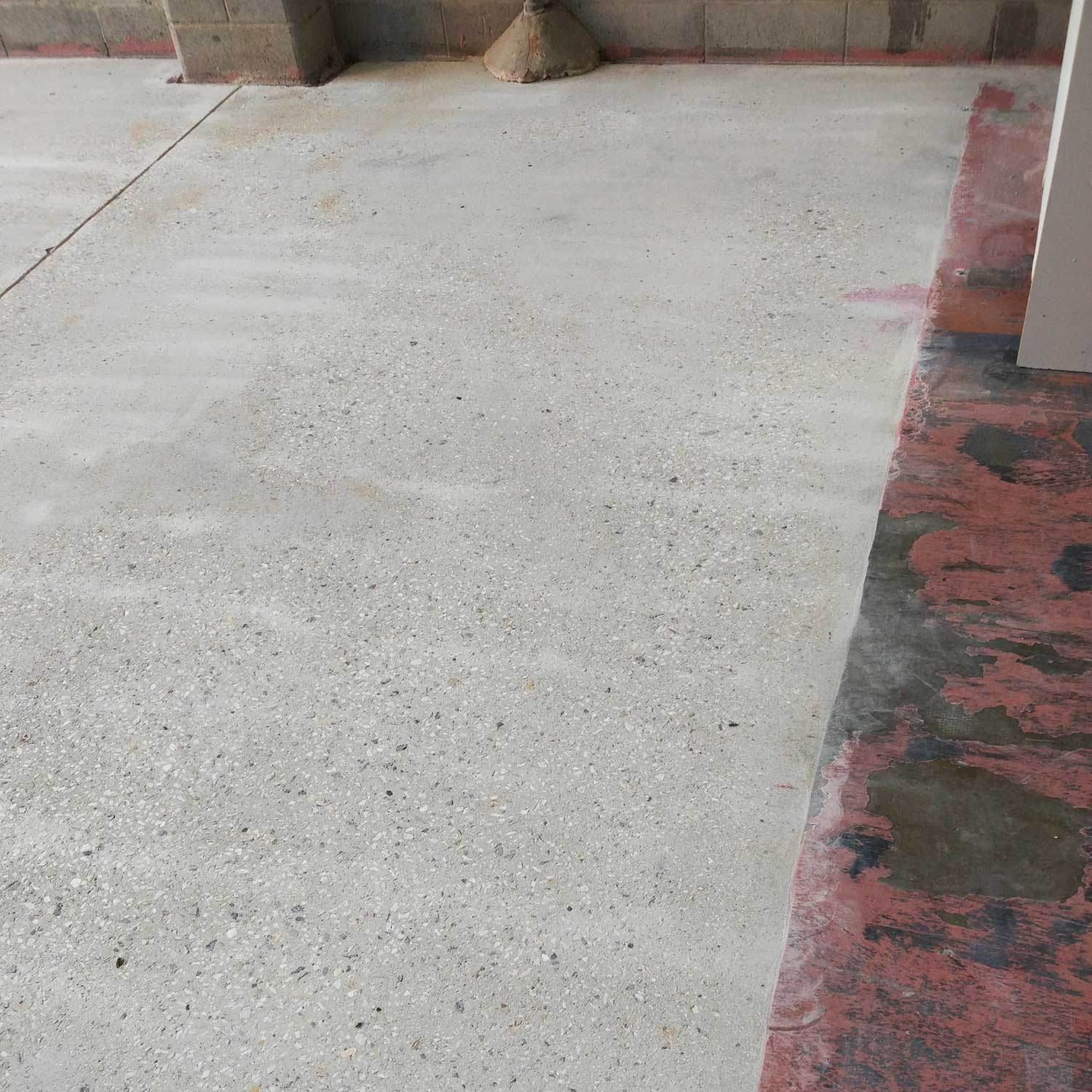Commercial Indoor Epoxy Removal by Burke Concrete Resurfacing